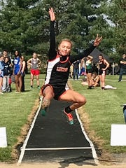 Lucas' Emily NIswander won the Division III district long jump title on her final attempt.