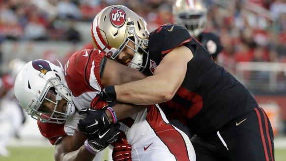 San Francisco 49ers linebacker Nick Bellore, right,