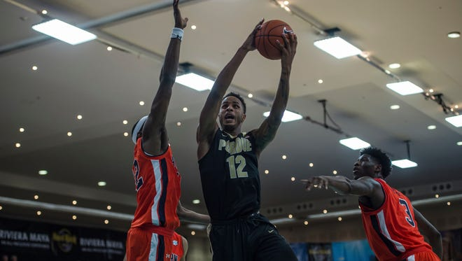 Purdue junior forward Vincent Edwards (12) drives to the basket against Auburn in the championship game of the Cancun Challenge.