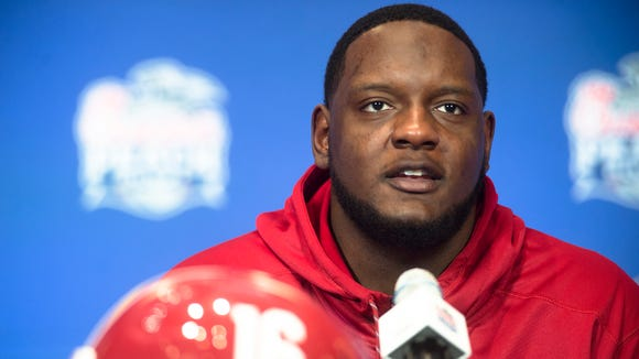 Alabama offensive lineman Cam Robinson speaks on Wednesday,