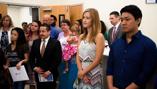 From left, Lan Khue Thi Huynh, Leah Rose Paley, Samuel Uribe, Jenny Plitsch, and Daniel Kim look on during their Naturalization Ceremony on the opening day of the U.S. Citizenship and Immigration Services field office in Montgomery, Ala., on Wednesday, June 14, 2017.