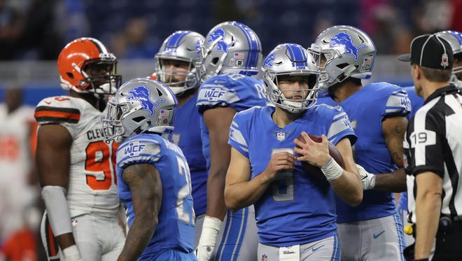 Matthew Stafford holds the ball after kneeling to end the game against the Cleveland Browns for a 38-24 Detroit Lions win on Sunday, Nov. 12, 2017 at Ford Field.