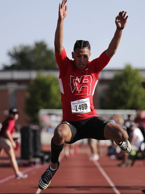 Isaiah Westfall, of Wisconsin Rapids, competes in the Division 1 long jump during the WIAA Track and Field Championships Friday,