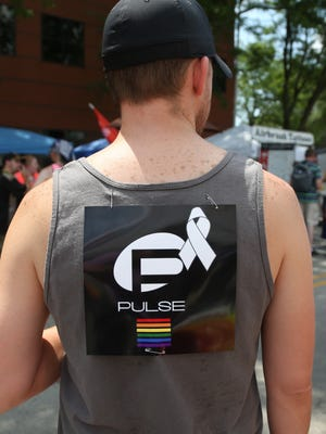 Mike Robinson, of Des Moines, said he found this photo on Facebook and printed it out an hour before coming to Pridefest in Des Moines.