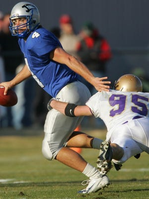 Carroll defensive end Jeff Shirley records a quarterback sack against Saint Francis (Ind.) in the NAIA national championship game in 2004.