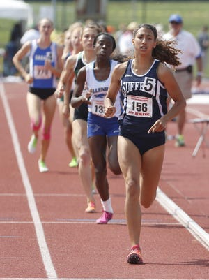 Suffern's Kamryn McIntosh leads the 800 meter run at the state track and field championships at the University at Albany, June 12, 2015. McIntosh set a meet 800 record with a time of 2:05.63.