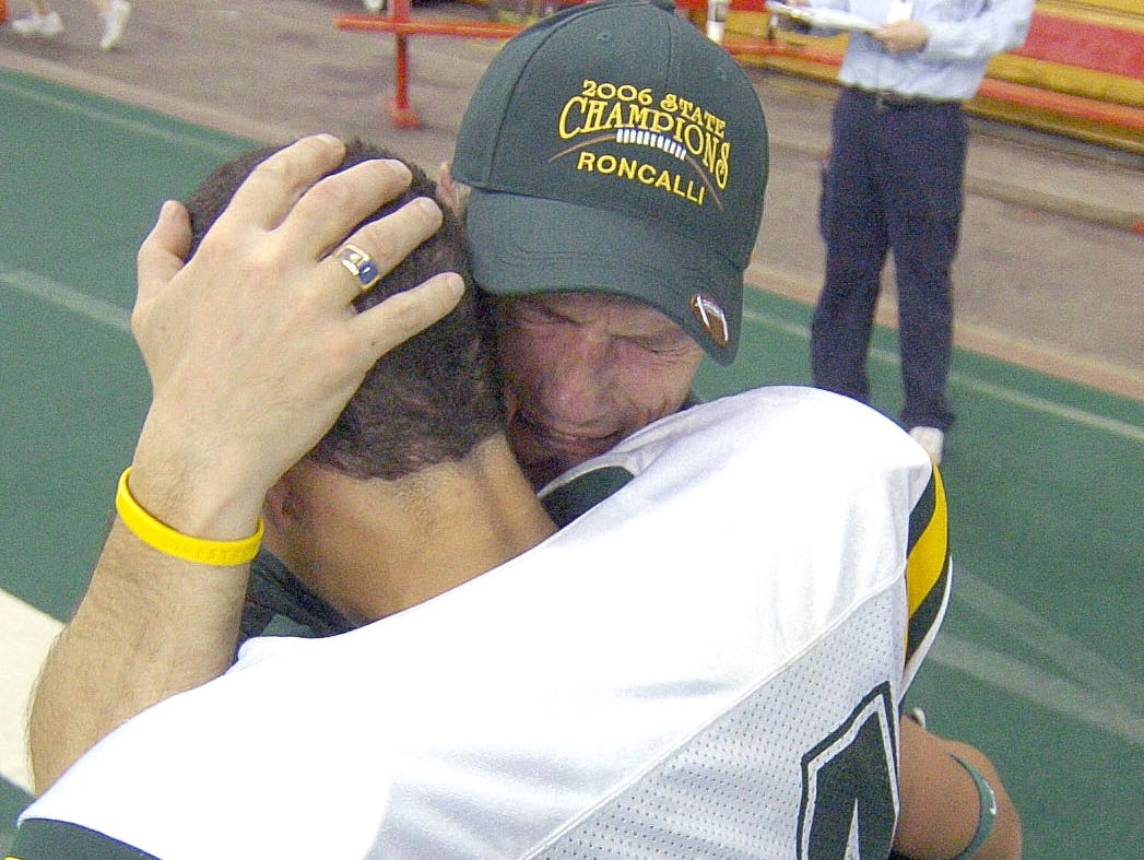 Aberdeen Roncalli head coach Terry Dosch hugs his son Logan at the end of the game as the Cavaliers won the Class 11 B Championship. (Lloyd B. Cunningham/Argus Leader) 10 November 2006