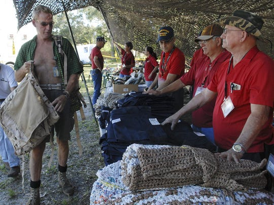 Stand Down for veterans in October 2012 at the American Legion Post 117 in Palm Bay. After receiving new backpacks, Tommy Johnston (L), selects new bedding and clothes.