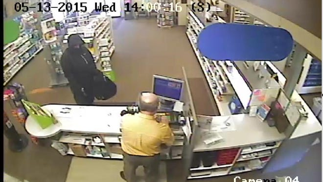 Police say the man seen in this surveillance photo reportedly threatened employees with a gun at a New London pharmacy Wednesday afternoon.