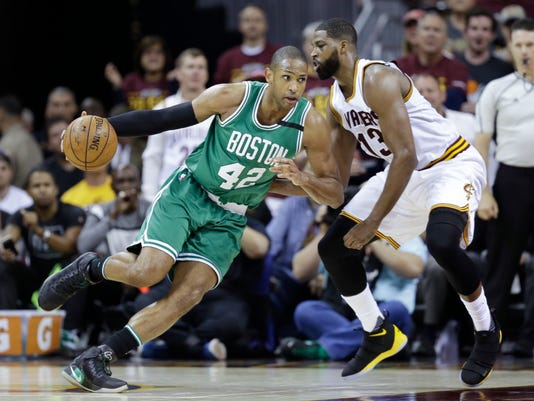 Boston Celtics' Al Horford (42), from Dominican Republic, drives on Cleveland Cavaliers' Tristan Thompson (13) during the second half of Game 4 of the NBA basketball Eastern Conference finals, Tuesday, May 23, 2017, in Cleveland. (AP Photo/Tony Dejak)