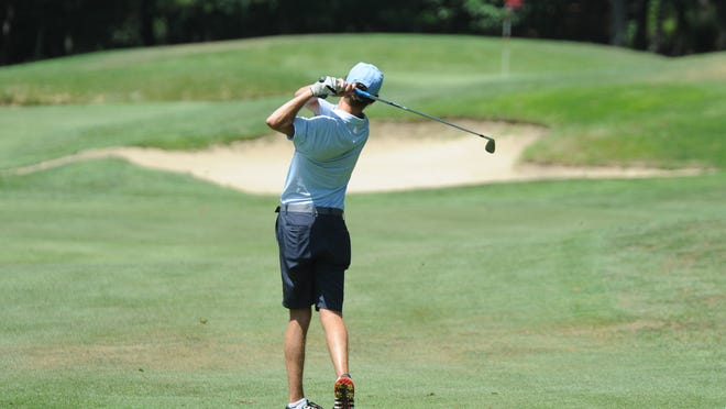 Olde Barnstable Fairgrounds' Connor Levesque follows through on a swing on the way to posting a 1-over-par 73 on Monday at Cranberry Valley Golf Course. To see more photos, go to www.capecodtimes.com/photos.