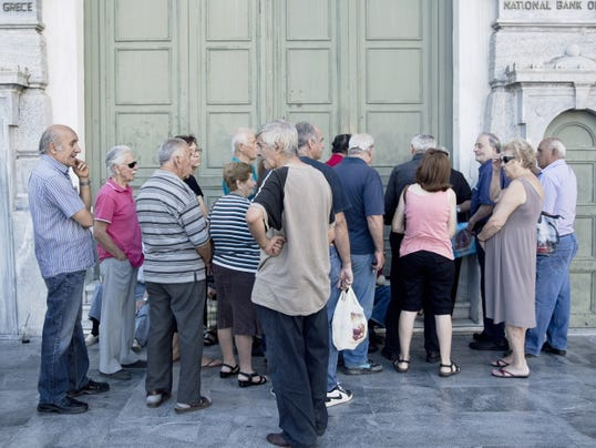 Pensioners wait for the opening of the national bank of Greece to withdraw a maximum of 120 euros (134) for the week Friday in central Athens.