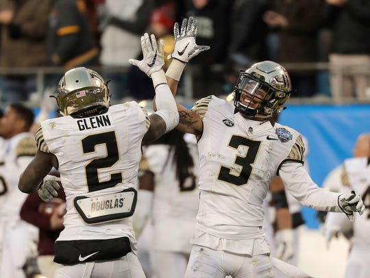 Wake Forest's Jessie Bates III and Cameron Glenn celebrate