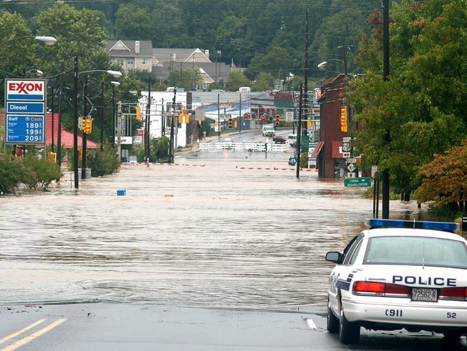 Police guard flooded Biltmore Ave. in Biltmore Village after the Swannanoa River overlowed its banks and flooded the area. Heavy rain from Hurricane Frances flooded many areas of WNC. 9/8/2004--Bill Sanders