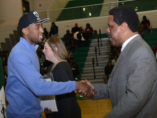 ANI Markel Brown Brooklyn Nets and former Peabody player Markel Brown (left) shakes hands with his former coach Charles Smith during a ceremony held Tuesday, Feb. 17, 2015 at Peabody Magnet High School where Brown's jersey was retired.-Melinda Martinez/mma