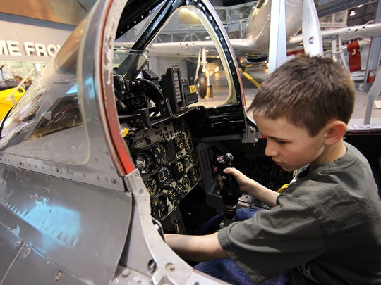 Bryce Barnes sits inside an F-100 cockpit trainer at Family Flight Fest at the EAA Aviation Museum in this file photo. This year's event is March 2 and 3.