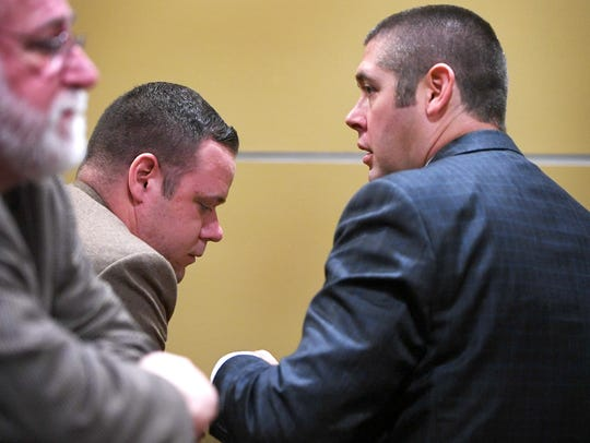 Chris Hickman speaks with his attorney, Thomas Amburgey,