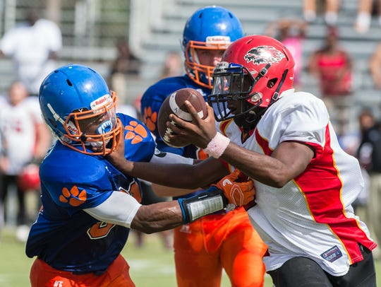 Arcadia's Lethan Williams (8) attempts to break a tackle