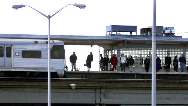 Passengers wait for an arriving train in this file photo from the Westmont Station of the PATCO Hi-Speedline, where a rail replacement is underway.