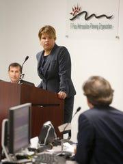City Rep. Cortney Niland looks on as Raymond Telles,