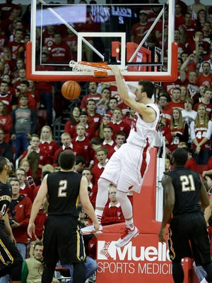 Wisconsin forward Frank Kaminsky throws down a dunk against Northern Kentucky.