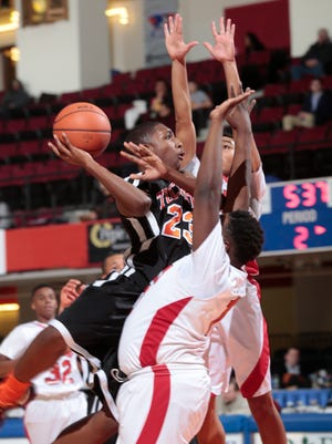 Tuckahoe's Jamon Murray shoots over a pair of Hamilton defenders in a Class C semifinal Monday. Murray's hot start sparked the Tigers to an upset victory.