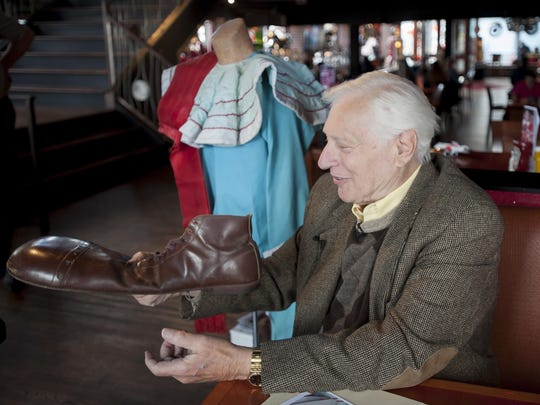 Art Cervi holds one of the original shoes that he wore for the show.