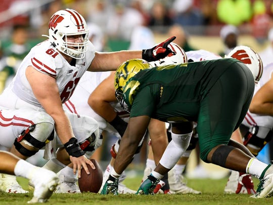 Aug 30, 2019; Tampa, FL, USA; Wisconsin Badgers offensive lineman Tyler Biadasz (61) looks to snap the ball during the second half against the South Florida Bulls at Raymond James Stadium. Mandatory Credit: Douglas DeFelice-USA TODAY Sports