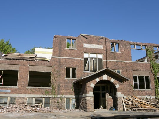 Work continues on May 21 to take down St. Philip Catholic