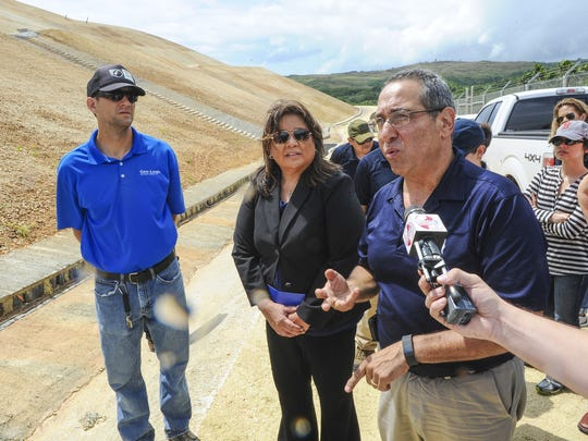 Paul Baron, front right, GHD Inc. principal construction engineer, explains to District Court of Guam Chief Judge Frances Tydingco-Gatewood, center, and others, how leachate fluid is collected and disposed of during a tour at the Ordot Dump on Monday, March 28.