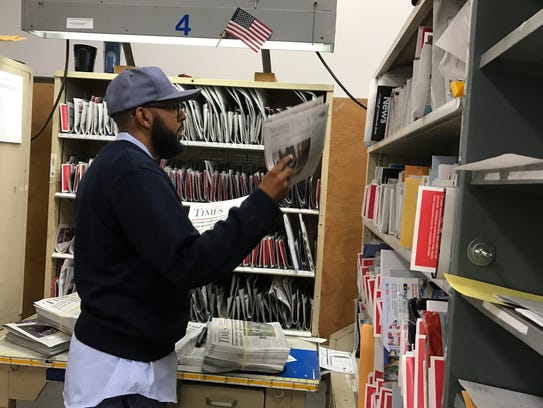 Cedar Grove letter carrier Jerell Stanford sorts through