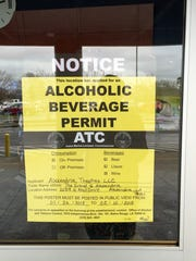 A notice at the Grand in Alexandria informing people that the theater has applied for a permit to serve alcohol.