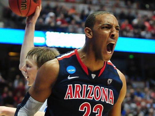 Arizona Wildcats forward Derrick Williams (23) reacts