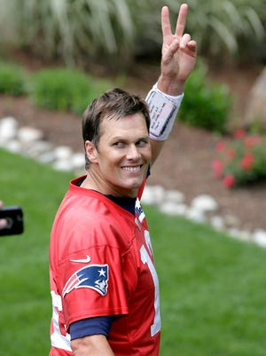 Tom Brady waved at reporters after a recent Patriots minicamp.