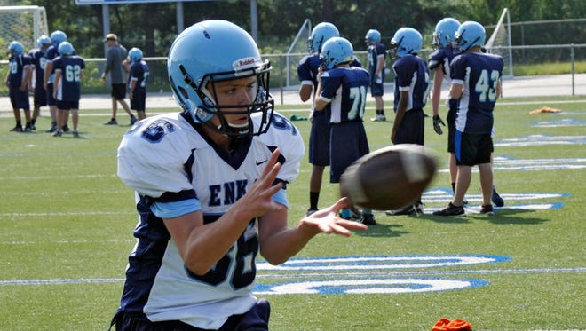 Enka's football team travels to Owen tonight for its season opener