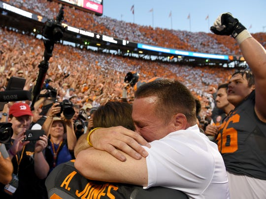 Tennessee head coach Butch Jones hugs his son Alex Jones after their 38-28 win over Florida Saturday, September 24, 2016 at Neyland Stadium.