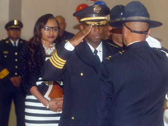 Opelousas Police Chief receives a salute from his fellow officer during swearing in ceremonies Saturday at the Opelousas Civic Center.