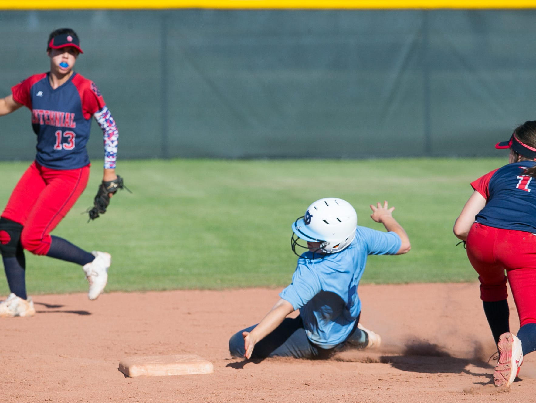 Deer Valley's Marlee Pieper dodges Centennial infielder Skylar McCarty's tag as she steals second base during a game on Thursday, April 14, 2015.