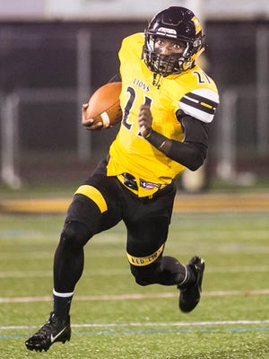 Red Lion's Paul Jones, runs the ball during the first quarter on Friday against Northeastern. The Lions improved to 5-0 with a 35-14 triumph over the Bobcats. Amanda J. Cain photo