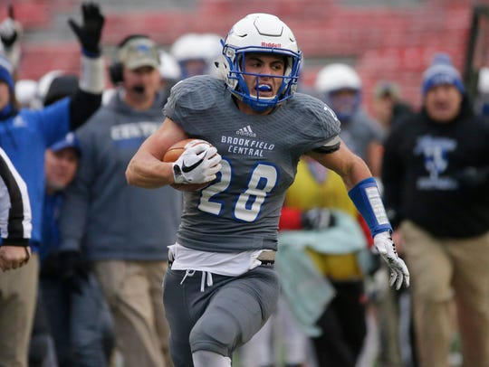 Brookfield Central running back Zach Hechman picks up 42 yards in the first quarter of a 14-13 loss to Waunakee in the Division 2 state football championship game Nov . 17.