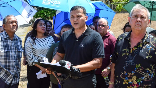 """Roy T. Quintanilla, center, says he was sexually abused by Archbishop Anthony Apuron when he was 12 years old, at a press conference in front of the Archdiocese of Agana Chancery Office in Hagåtña on May 17, 2016. Quintanilla asked for an apology from the archbishop, and encourages anyone with a similar story to step forward. """"I will not be silent anymore,"""" added Quintanilla."""