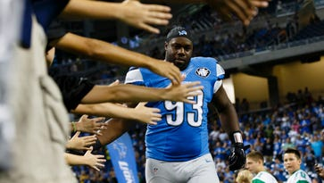 Detroit Lions defensive lineman Tyrunn Walker takes the field during player introductions Sept. 3, 2015.