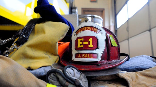 December 2009 file photo of gear for one firefighter stacked in a neat pile on the floor next to the fire truck for easy access should a call come in while working at the Staunton Fire Department.