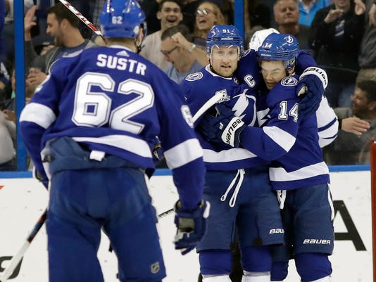 Tampa Bay Lightning left wing Chris Kunitz (14) celebrates his goal against the Toronto Maple Leafs with center Steven Stamkos (91) and defenseman Andrej Sustr (62) during the first period of an NHL hockey game Monday, Feb. 26, 2018, in Tampa, Fla. (AP Photo/Chris O'Meara)