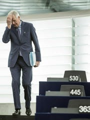 European Union's chief Brexit negotiator Michel Barnier arrives at a plenary session in the European Parliament in Strasbourg, eastern France, Wednesday, March 13, 2019. British lawmakers rejected May's Brexit deal in a 391-242 vote on Tuesday night. Parliament will vote Wednesday on whether to leave the EU without a deal.