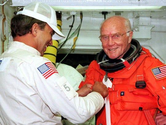White Room technicians help Sen. John Glenn, D-Ohio,