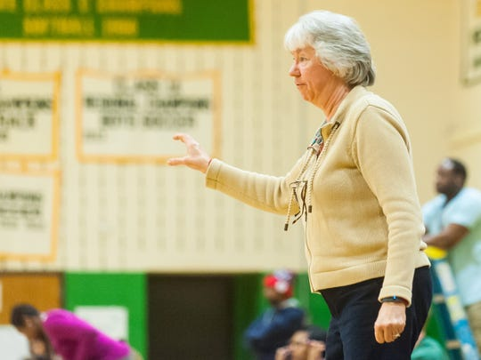 Pocomoke head coach Gail Gladding adjusts her players from the bench against Mardela on Tuesday evening at McCool's House of Hoops in Mardela.