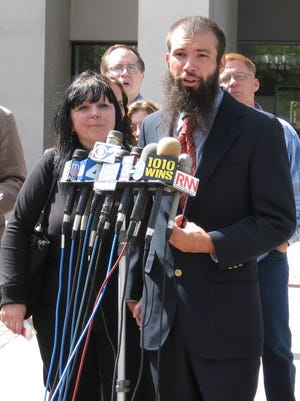 In this handout photo Jeffrey Deskovic, 33, right, stands with his mother Linda McGarr as he addresses the media in front of the Westchester County Courthouse in White Plains, N.Y., Wednesday, Sept. 20, 2006. Deskovic, who was convicted as a teenager of raping and murdering a 15-year-old classmate despite DNA evidence in his favor was freed Wednesday, after a new DNA test implicated another man and the new suspect confessed.