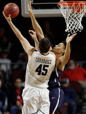 Butler's Andrew Chrabascz shoots around Arizona's Chance Comanche during the first half of an NCAA college basketball game Friday, Nov. 25, 2016, in Las Vegas.
