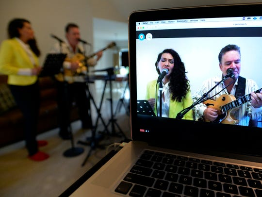 Angelo and Veronica Petrucci sing as they host religious